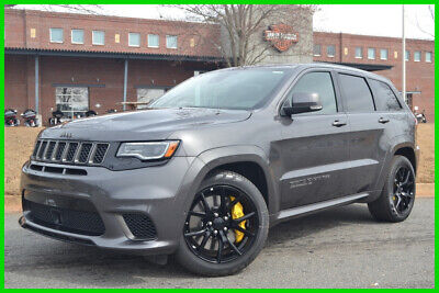 2018 Jeep Grand Cherokee TRACKHAWK LIKE NEW ONLY 19 MILES SAVE $$$ WE FINANCE! 6.2L 707 HP AWD 4X4 8.4 NAV DUAL ROOF TOW PKG LAGUNA LEATHER RED BELTS BLK WHEEL