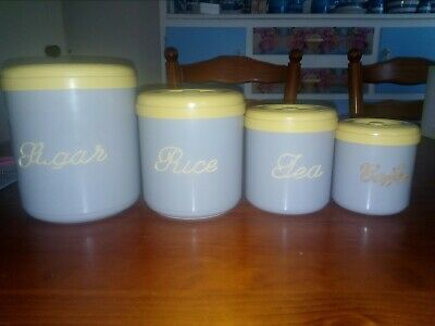 4 xRetro Nally Ware kitchen canisters, yellow and grey