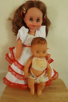2 netta dolls - small baby & larger doll - dressed