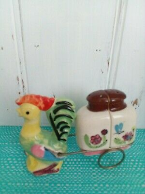Chicken pulling wire cart Salt And Pepper Shakers.