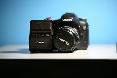Canon EOS 7D 18.0MP Digital SLR Camera Body, Charger, and 100mm f/2 USM