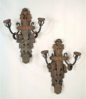 PAIR OF EARLY 20th CENTURY CARVED WOOD AND WROUGHT IRON DOUBLE ARM SCONCES