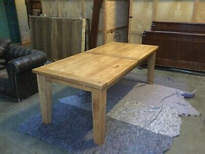 Large solid oak extending dining table