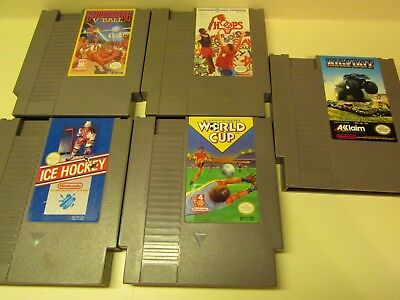 Lot 5 Nintendo NES video Games, Hoops, World Cup, Bigfoot, Ice Hockey and V-Ball