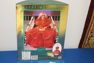 Happy Holidays Barbie in Poinsettia red and glittery gold, original box 1993