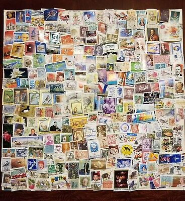 Worldwide 5000 different stamps mint and used off paper