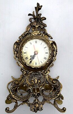 A Cast Brass Reproduction Mantle Clock