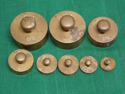 Lot of 8 vtg brass scale balance weights. Grams 200 100 50 20 10 5
