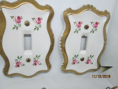 Set of Ceramic single switch plates and a bonus set of knobs