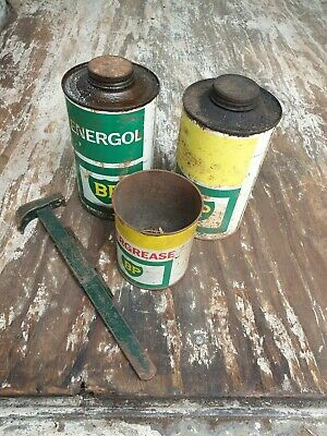 Oil cans x 3 (x2 1 quart & 1 small grease tin).