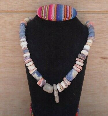 Peruvian pre-Columbian style necklace made with natural stones and piruros