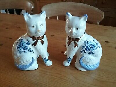 Pair of china mantel cats, blue and white
