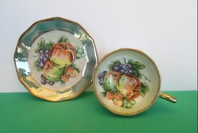 Porcelain Green and White Footed Teacup and Saucer with Fruit Pattern