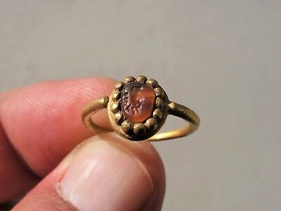 ancient Roman gold ring, carnelian intaglio displayed a bird