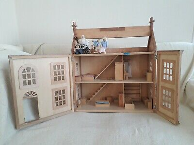 Wooden Dolls House With Wooden Accessories