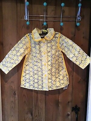 Mothercare Yellow Flower Raincoat Age 12-18  BNWT