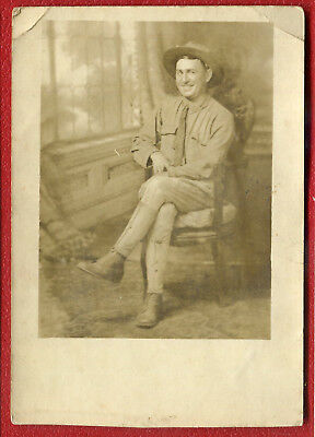 US Army Dough Boy posing sitting down WW1 real photo postcard RPPC