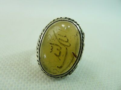 old Islamic silver ring engraved white on a brown semi transparent agate stone