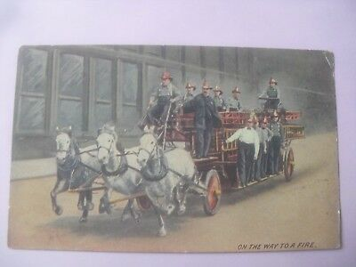 Fire engine horse drawn on the way to a fire  postcard