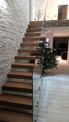 Floating staircase with glass balustrade. Contemporary, bespoke staircases.