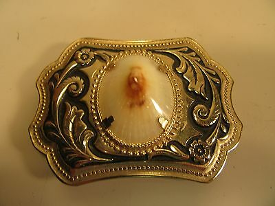 Nice brass and shell belt buckle
