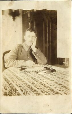WWI German? Soldier uniform seated table ~ RPPC real photo postcard dated 1916