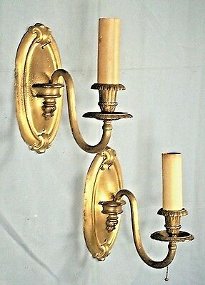 AN ELEGANT PAIR OF EARLY 20th CENTURY ART NOUVEAU BRASS OVAL BACK SCONCES