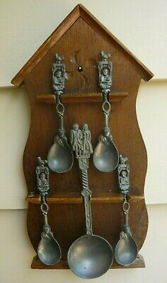 Collection of 5 antique cast pewter spoons - made in Holland - on a rack. VGC
