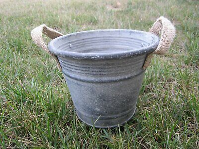 Weathered metal bucket / planter with burlap handles