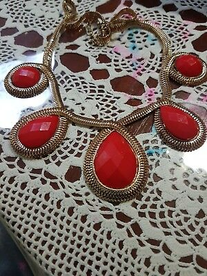 A Gold And  Red Necklace