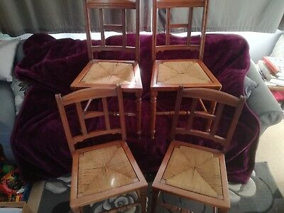 Four Edwardian Walnut Dining Chairs with wicker drop in seats