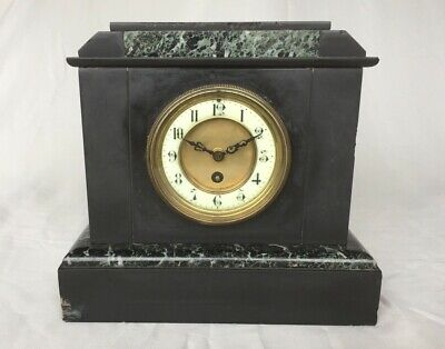 French Antique mantel clock. About 1850 in slate and marble. Working well.