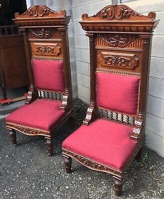Pair Of Carved Walnut Egyptian Revival Chairs