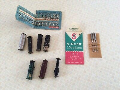 Antique Cast Iron Singer Treadle Sewing metal bobbins and size 16 needles etc