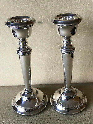 Solid Silver pair of candle sticks 1967