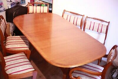 Regency style extendable mahogany dining table, with 6 chairs including 2 carver
