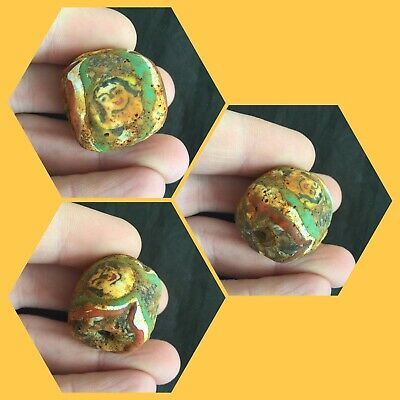 Rare ancient Phoenician glass bead with faces , 300 bc