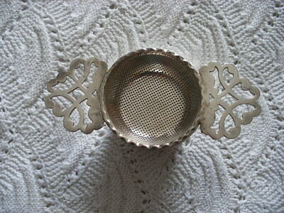 A  Vintage Silver Plated Tea Strainer With Drip Bowl