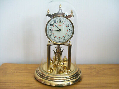 Anniversary Large German Kundo Torsion clock with its glass dome
