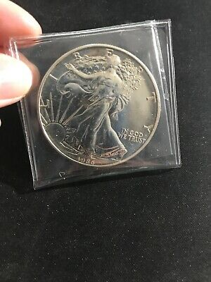 1986 First Year American Silver Eagle Coin 1 OZ Semi key - has small dot on top
