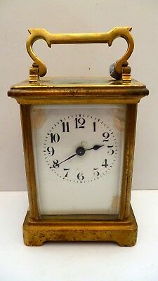 BRASS CARRIAGE CLOCK--HEIGHT 4.25 ins--WORKING ORDER