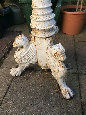 large ornate antique cast iron garden stand with three griffin feet