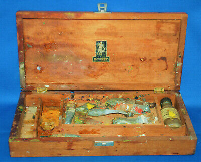 A characterful antique wooden Rowney artist box, some contents, ideal film prop