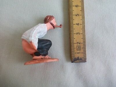 Caganer. Vintage Pooping figure, with pipe. Belén. Spanish Christmast figurine.