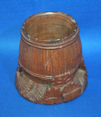 An antique carved wooden Black Forest style spill or match pot, barrel and leaf