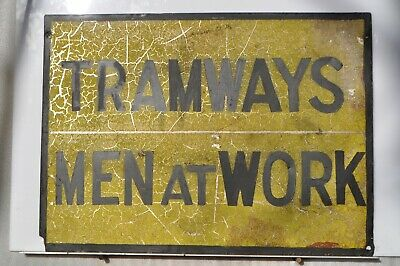 MMTB. Men at work sign