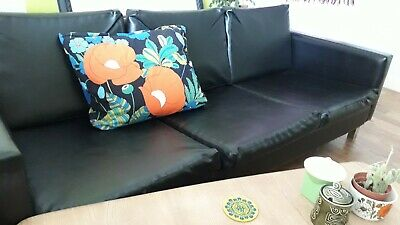 1960s original black vinyl retro sofa. Great condition and plenty of style.