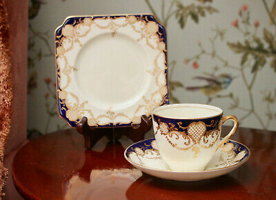 An Antique Royal Doulton Cup and Saucer & Plate