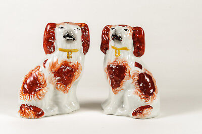 Antique handpainted pair of Staffordshire spaniels in russet