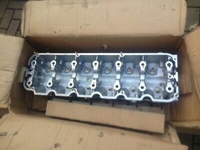 BMW E30 M20 325 cylinder head bare, NEW GENUINE BMW in the box NLA  11121707032